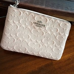 Gorgeous Coach Signature Embossed Blush Wristlet